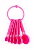 Ustensiles en plastique roses de traitement au four Photographie stock libre de droits