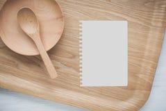Ustensiles vides de carnet et de cuisine Photos libres de droits