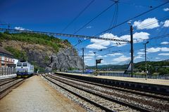 Usti nad Labem, Czech republic - June 30, 2018: train track with electric locomotive leading from main train station to Marianska. Skala rock aroung Labe river Royalty Free Stock Photos