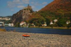 Usti nad Labem, Czech republic - September 08, 2018: orange model of legendary czechoslovak car Skoda 110R named Erko from year 19. 80 near Elbe river with royalty free stock image