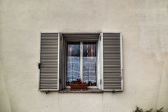 Ustic wall with open window Stock Photos