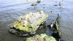 Ustka, Baltic Sea, Poland, seaport with old stones and walls stock footage
