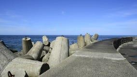 Ustka, Poland, Baltic Sea, wavebreaker. At the mole of the seaport stock video