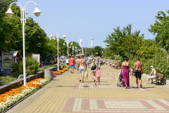 Ustka - Poland. Promenade along the beach with the walking vacationing people in Ustka, Poland Stock Photo
