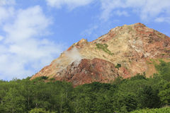 Usu-zan mountain, active volcano near Toya lake, Hokkaido, Japan. View of Usu-zan mountain Mount Usu, an active volcano near Toya lake, the famous tourist Royalty Free Stock Photography