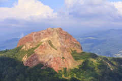 Usu-zan mountain, active volcano near Toya lake, Hokkaido, Japan. View of Usu-zan mountain Mount Usu, an active volcano near Toya lake, the famous tourist Royalty Free Stock Photo