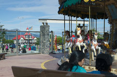 USUAIA, ARGENTINA, 05 DICEMBER 2016: day off in Ushuaia, numerous people relaxing next to amusement park stock photos