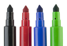 Usual felt-tip pens. Usual real felt-tip black, red, blue, green pens macro isolated on white stock photo