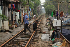Usual life and houses on the railway track Stock Image