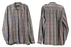 The usual old man`s checkered shirt hangs in the closet. Isolated on white studio set Royalty Free Stock Images