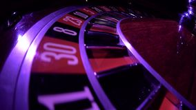 Usual roulette wheel running with fallen white ball, top view. Zero. Close up. Usual roulette wheel running with fallen white ball, top view, spinning wheel with stock footage