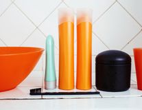 Usual stuff in bathroom, shampoo, accessories, black stylish too. Thbrush royalty free stock photography