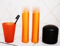 Usual stuff in bathroom, shampoo, accessories, black stylish too. Thbrush stock photos
