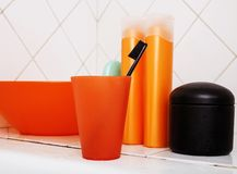 Usual stuff in bathroom, shampoo, accessories, black stylish too. Thbrush stock photography