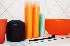 Usual stuff in bathroom, shampoo, accessories, black stylish toothbrush, casual normal real background close up. Usual stuff in bathroom, shampoo, accessories stock photo