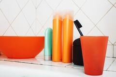 Usual stuff in bathroom, shampoo, accessories, black stylish toothbrush, casual normal real background close up. Usual stuff in bathroom, shampoo, accessories stock images