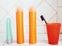 Usual stuff in bathroom, shampoo, accessories, black stylish toothbrush, casual normal real background close up. Usual stuff in bathroom, shampoo, accessories royalty free stock photography