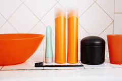 Usual stuff in bathroom, shampoo, accessories, black stylish toothbrush, casual normal real background Royalty Free Stock Images