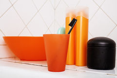Usual stuff in bathroom, shampoo, accessories, black stylish toothbrush, casual normal real background Stock Photos