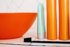 Usual stuff in bathroom, shampoo, accessories, black stylish toothbrush, casual normal real background Royalty Free Stock Photos