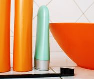 Usual stuff in bathroom, shampoo, accessories, black stylish too. Thbrush stock image