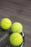 Usual tennis racquet with three green balls Royalty Free Stock Image