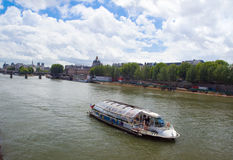 The usual tour of the Seine, Paris. Royalty Free Stock Photo