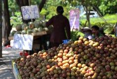 Usual vietnam street market. Plums. stock photo