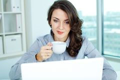 Usual workday. Image of a pretty businesswoman on her usual working day Royalty Free Stock Images