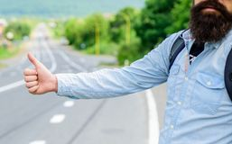 Usually use thumb up to inform drivers hitchhiking. But in some cultures gesture offensive so you risk to be killed by. Furious driver you just insulted royalty free stock image