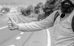 Usually use thumb up to inform drivers hitchhiking. But in some cultures gesture offensive so you risk to be killed by. Furious driver you just insulted royalty free stock photography