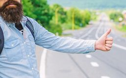 Usually use thumb up to inform drivers hitchhiking. But in some cultures gesture offensive so you risk to be killed by. Furious driver you just insulted stock photo