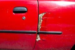 Uszkadzający czerwony samochód Fotografia Royalty Free