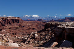 UT-Canyonlands National Pk-White Rim Rd-Monument. Monument Canyon reaches out to the majestic and snow-tipped La Sal Mountains in the background Stock Photography