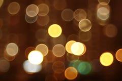 Ut ur fokusabstrakt begreppljus nattstad Arkivfoto