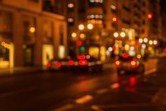 Ut ur fokusbild av en stadsplats på natten Royaltyfria Bilder