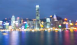 Ut ur fokuserad bakgrund för abstrakt begrepp för stadsnattbokeh Arkivfoton