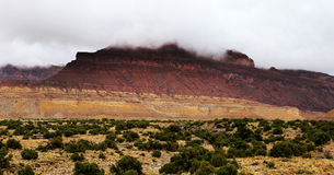 Utah Desert Mountain Storm. Storm clouds cover the top of this mountain in the Utah desert Royalty Free Stock Images