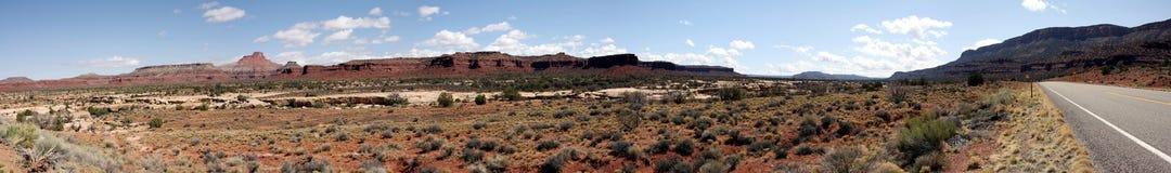 Utah desert panorama. Desert and scrubland of Utah with road running through Stock Images