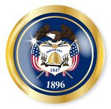 Utah Flag Button. Utah state flag button with a gold metal circular border over a white background Stock Photo