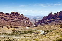 Utah Highway Gorge. Interstate 70 in Utah curves steeply downhill from the bluffs of San Rafael Reef toward Green River Royalty Free Stock Images