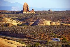 Utah Scenic Road. RV Adventure. Small RV on the Road in the Arches National Park, Utah, USA. Recreation Vehicle on the Scenic Road royalty free stock photo