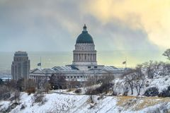 Utah State Capital Building on a frosty winter day. The famous Utah State Capital Building in Salt Lake City viewed in winter. A snow covered hill with road stock images