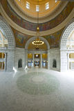 Utah State Capitol Rotunda. The rotunda of the Utah State Capitol with chandelier, arches, and circular patterned floor Royalty Free Stock Photography
