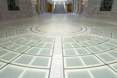 Utah State Capitol Rotunda Floor. The circular pattern on the Utah State Capitol rotunda floor with staircase and columns Royalty Free Stock Image