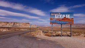 Utah state sign on highway. Utah state sign at border on highway in desert on sunny day Stock Image