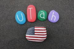 Utah state, United States of America, souvenir with colored stones and USA flag over black volcanic sand. Utah, state in the western United States of America. It stock photography