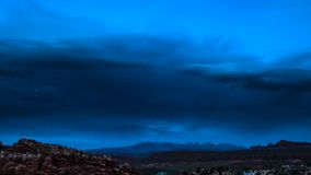 Utah Time-lapse. Dark clouds moving over the Arches National Park towards the La Sal mountains stock footage