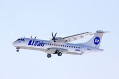 UTair ATR-72. NOVYY URENGOY - MARCH 23, 2013: UTair ATR-72 arrives at Novyy Urengoy International Airport, Russia Royalty Free Stock Photo