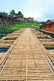 Utamanusorn bridge or Morn bridge, Thailand. It is the longest bamboo bridge in Thailand and the second one in the world. It is across Songkhalia river in Stock Photos